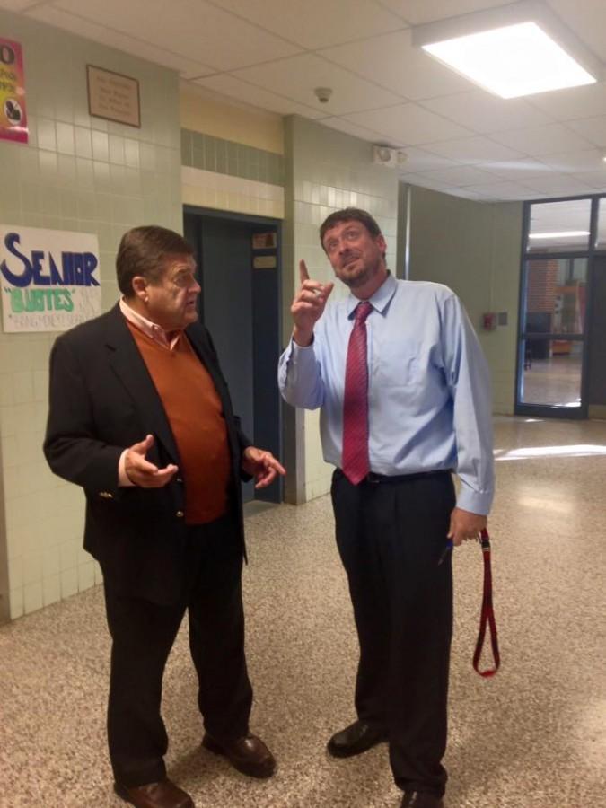 Congressman tours school with administrators