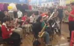 Band accompanies shopping children for holiday event