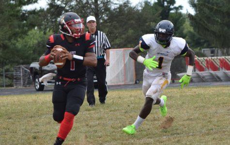 Varsity quarterback sets school touchdown record