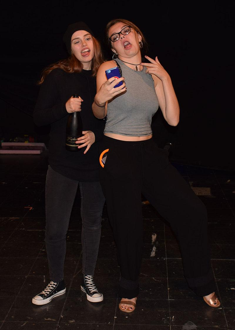 "Junior Bella Martin (drunken Aunt Fiona) and sophomore Shannon Trageser (Detective Meyers) rehearse for the dinner theater production ""Kiss the Bride"" Oct. 6. The play opens Oct. 27 and runs until Oct. 29. Tickets are $20, pre-sale only."