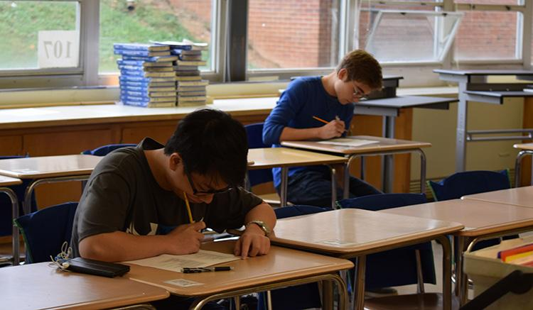 Seniors+Kevin+Kuo++and+Matt+Wilhide+redo+an+assignment+for+Advanced+Placement+Economics+in+room+107+in+mid-October.+Wilhide+called+the+redo+experience+helpful.+%E2%80%9CIt+gives+kids+more+of+a+drive+to+go+back+to+material+they+missed%2C%E2%80%9D+he+said%2C+adding+that+they+do+more+than+merely+bolster+grades.