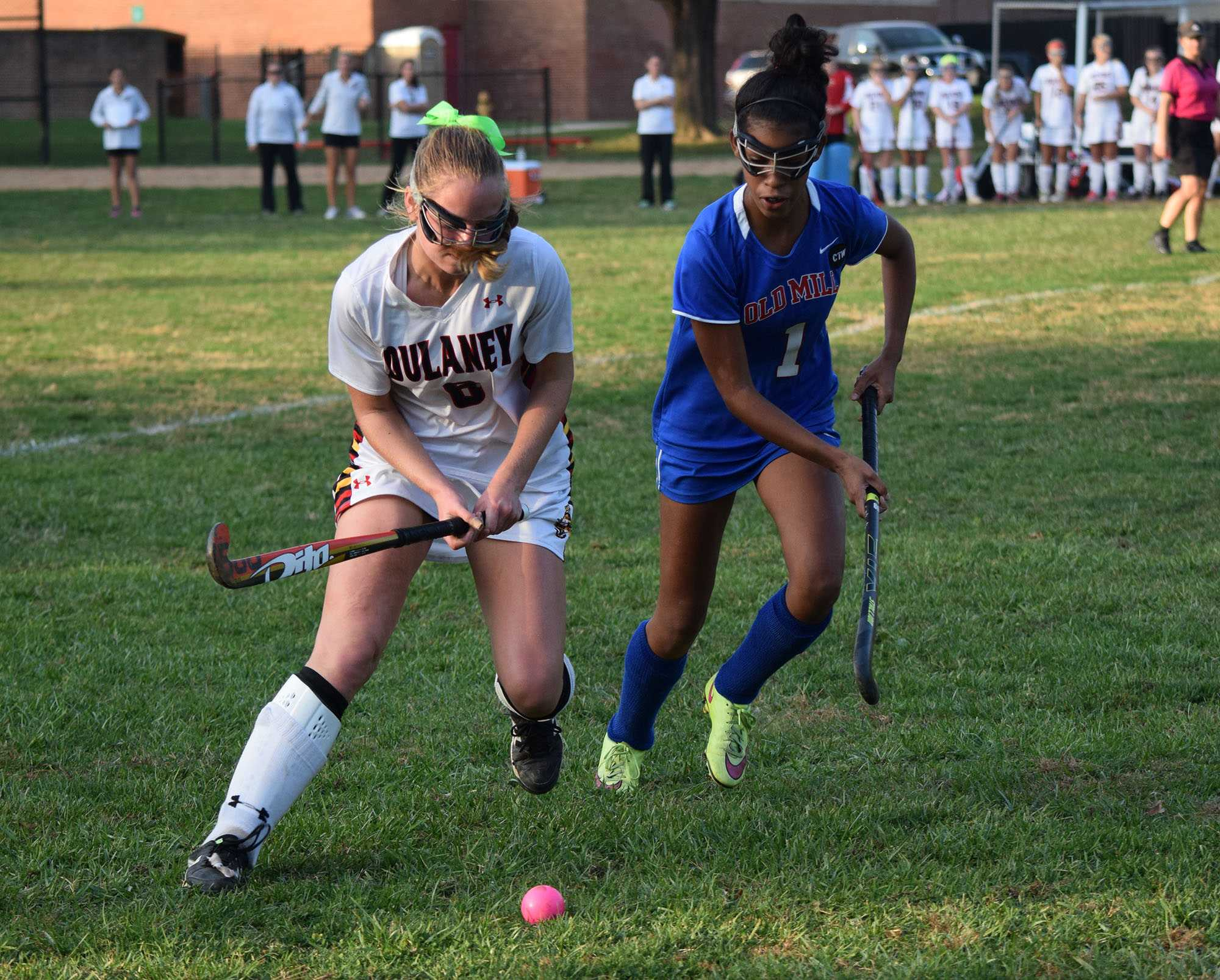 Senior midfielder Claire Podles eludes a defender from Owings Mills.