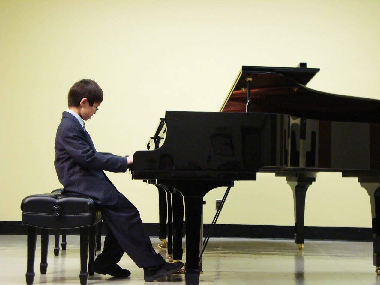 """A young Cheng performs during a piano recital about a decade ago. """"At the time, I really wasn't interested, but I'm glad that I learned at such a young age because it gave me a foundation,"""" Cheng said."""