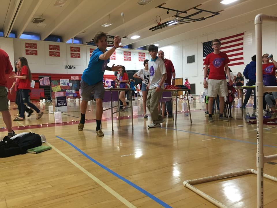 Students play a horseshoe-like game in the gym during last year's Relay for Life April 16. As a fundraiser, groups brought their own games and charged for tickets to play.
