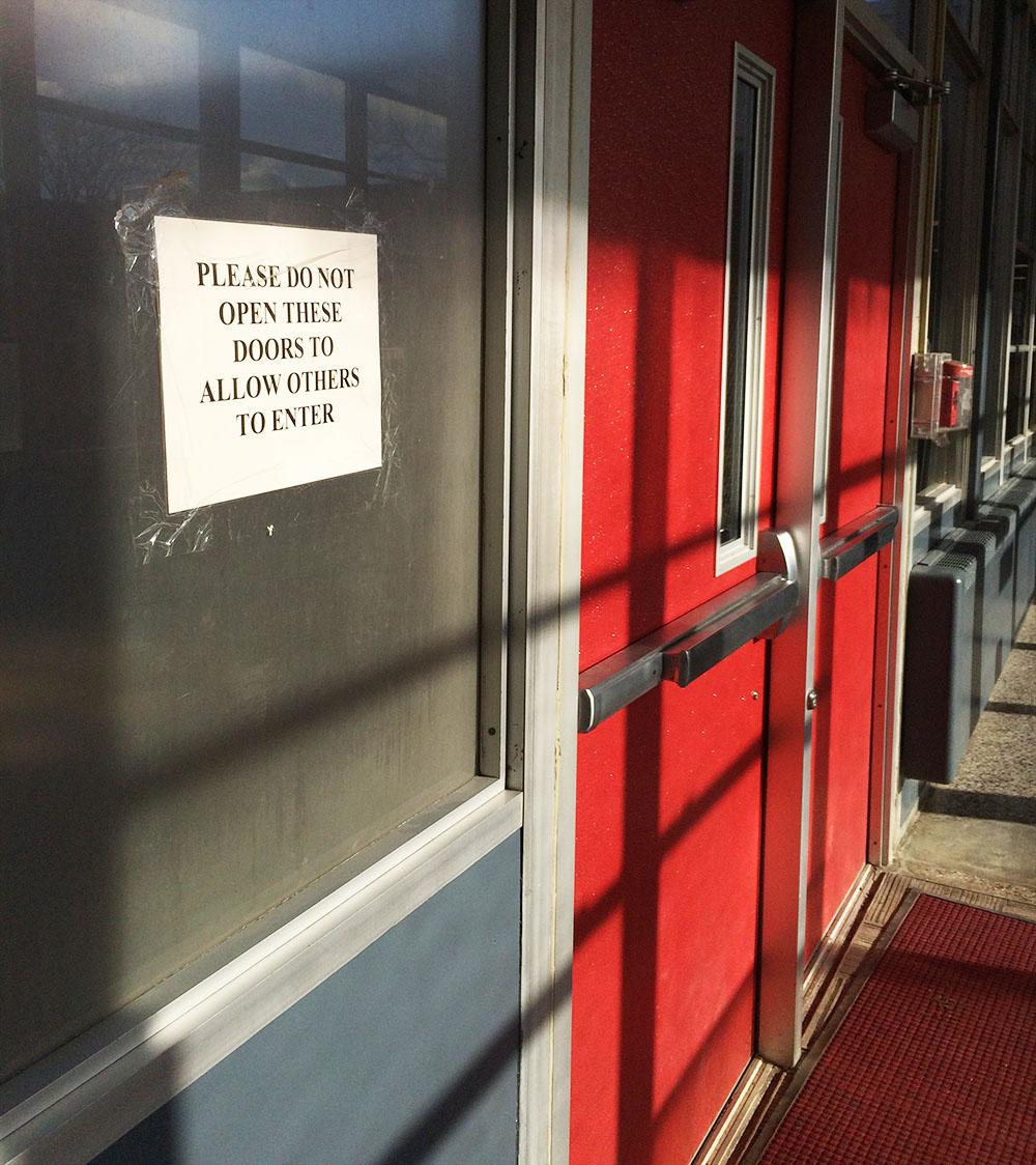 The sign on the doors in the main office hallway aims to deter students from letting others inside the building. Students are still being let in by teachers and their peers, an anonymous source reported.