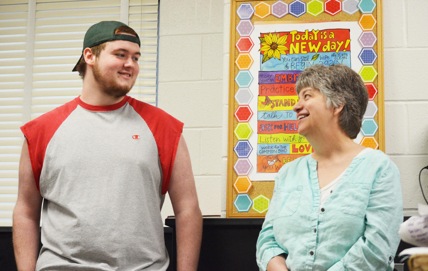 """Davidson and science teacher Laura Braly catch up after first period in room 216 May 11. """"[Braly] taught my paramedical biology class, which is what pushed me to major in biology,"""" Davidson said. He will attend Stevenson University."""