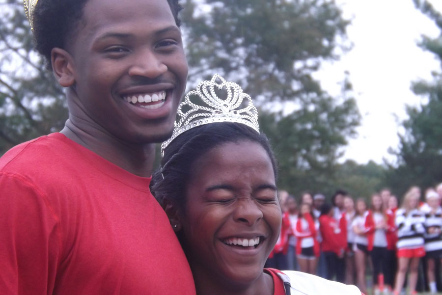 Seniors Isaiah Lamb and Kayla Wheeler share a laugh after being elected as homecoming king and queen during the pep rally Oc. 10.