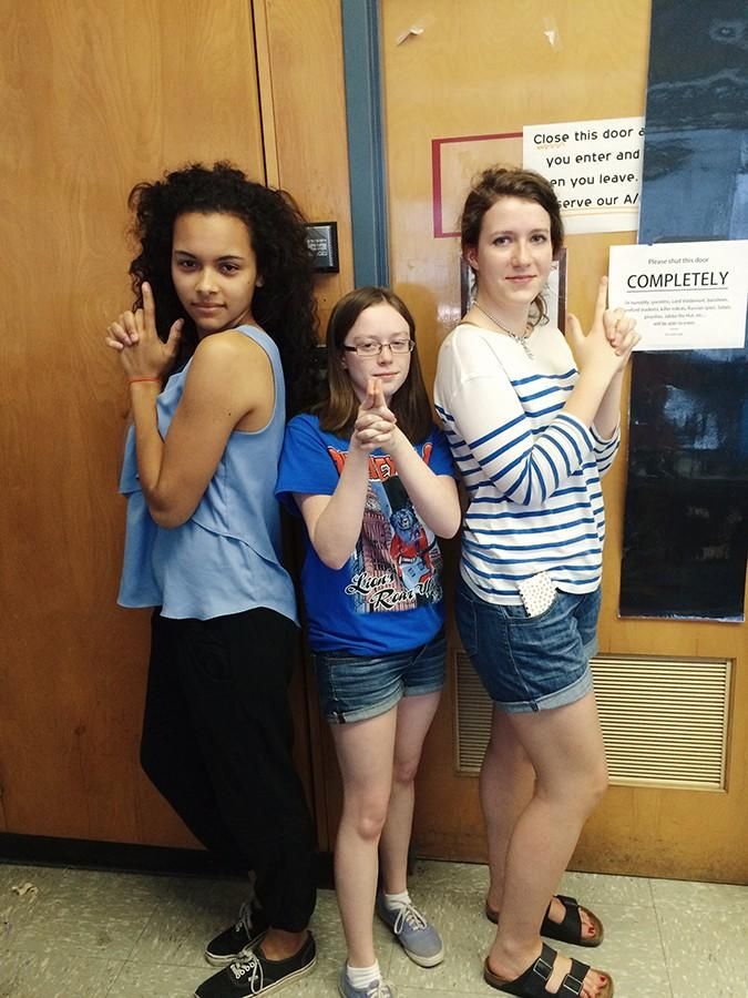Juniors Stephanie Rountree, Christine Condon and Sarah Feustle pose for a photo. The three will be the managing editors of the Griffin next year.