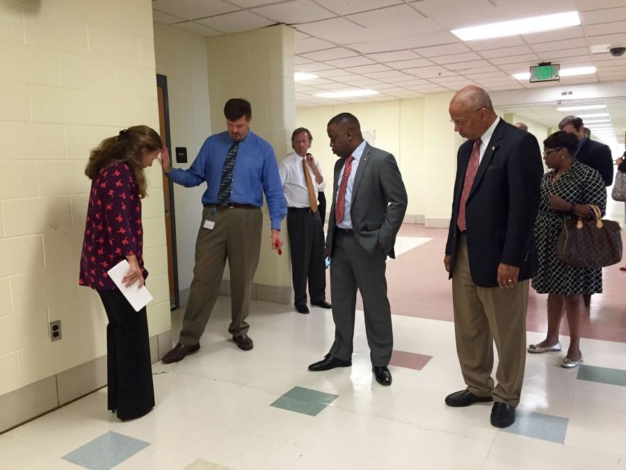 Assistant principal Tom Dugas and BCPS Board Members show Lieutenant Governor Boyd Rutherford (far right) the damaged infrastructure in the new wing.