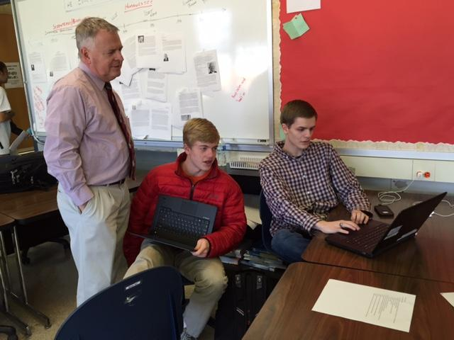 Business and accounting teacher Pat Holt talks with sophomore Daniel O'Donnel and junior Josh Talley, who are retaking a test Dec. 10.