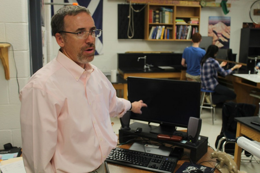 Physics teacher Steve Shaw demonstrates how the computers are used in his classes.