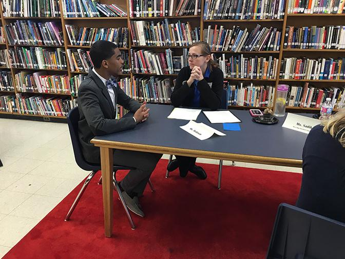 "Junior Xavier Engleton of Kathy Roeder's Honors 11 English class participates in Junior Interviews. ""I'm going to rock this interview,"" Engleton said, before walking into the library to meet his interviewer."