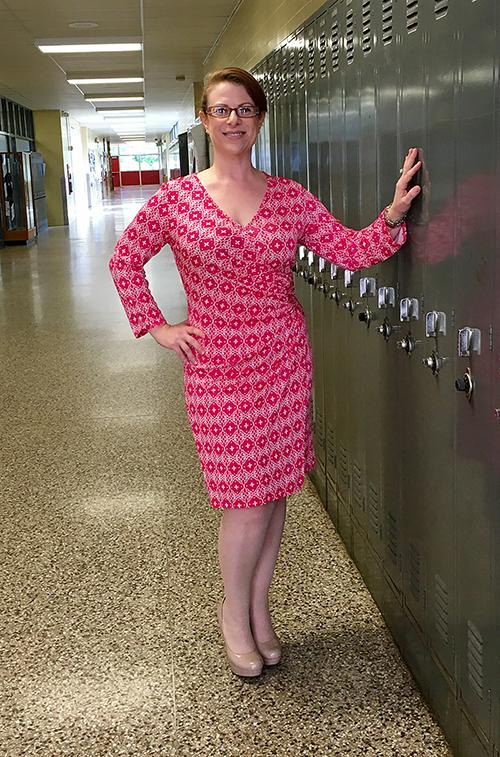 """Spanish teacher Judy Frumin poses in front of the library to show her outfit.  """"Dress for your age and for your body type. There are people my age who refuse to believe they're my age, and that is a no-no,"""" Frumin said."""