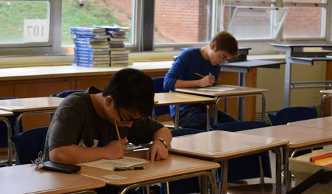 "Seniors Kevin Kuo  and Matt Wilhide redo an assignment for Advanced Placement Economics in room 107 in mid-October. Wilhide called the redo experience helpful. ""It gives kids more of a drive to go back to material they missed,"" he said, adding that they do more than merely bolster grades."