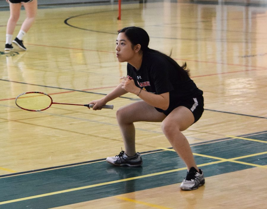 Senior+Amanda+Song+squats+and+prepares+for+a+hit+in+the+Girl%E2%80%99s+Doubles+first+match+against+Carver+as+a+part+of+the+Oct.+29+tournament+at+George+Washington+Carver+Center+for+Arts+and+Technology.+Song+played+with+senior+Michelle+Lin+and+won+the+first+match+15+to+7+against+Carver%2C+lost+the+second+13+to+15%2C+and+won+the+last+15+to+10.+Song+and+Lin+took+home+a+gold+medal+after+playing+Perry+Hall%2C+winning+both+matches+15+to+13+and+15+to+12.+