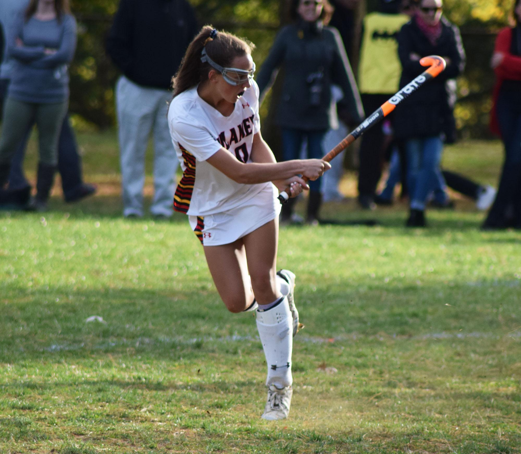 Junior+midfielder+Maggie+Kelly+goes+for+a+hit+in+the+MPSSAA++regional+semifinal+game+Oct.+31.+The+team+went+on+to+win+3-1+against+Catonsville.+