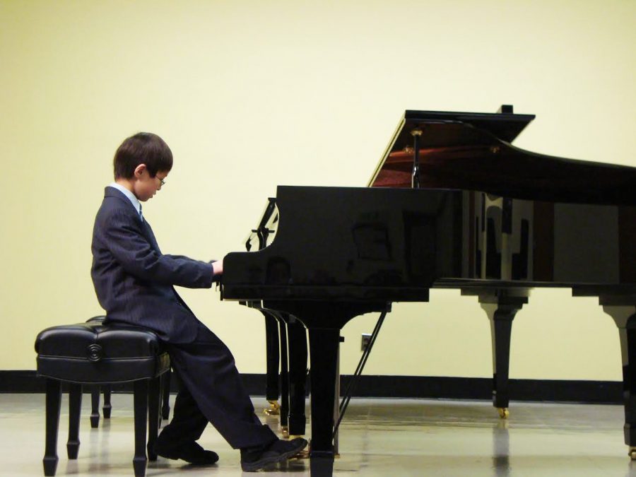 "A young Cheng performs during a piano recital about a decade ago. ""At the time, I really wasn't interested, but I'm glad that I learned at such a young age because it gave me a foundation,"" Cheng said."