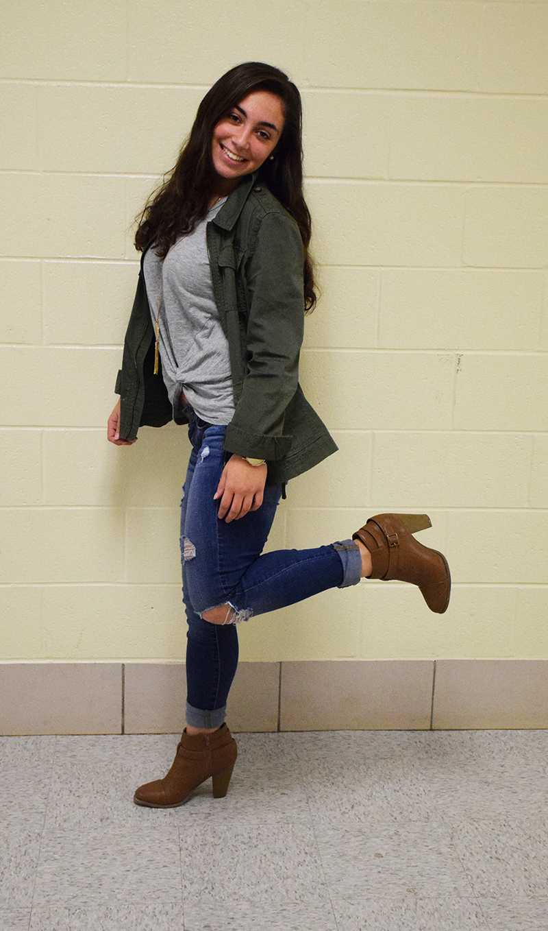 Senior Arianna Minas  sports a green cargo jacket from Nordstrom and a twist-up shirt with a layered necklace, both from Francesca's, ripped jeans from American Eagle and booties from DSW Dec. 7.