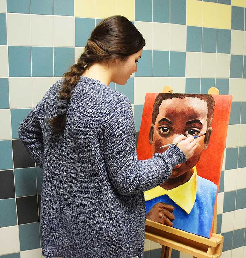Junior+Madi+Sedgwick+paints+a+portrait+of+a+young+boy+inspired+by+her+mission+trip+to+Kenya.