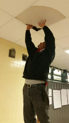 Custodian Derek Williams fixes a leak on the first floor in March 2016.