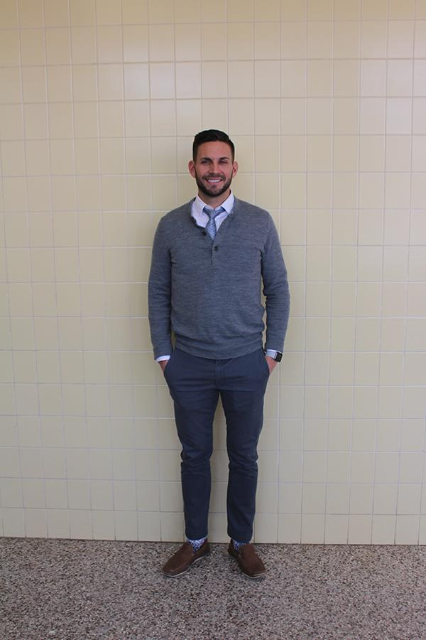 Guidance counselor Daniel Skelton sports a sweater, khakis and tie each from Banana Republic along with a dress shirt from Express Jan. 27.