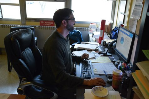 Guidance department chairman John Komosa works at his desk Dec. 12.