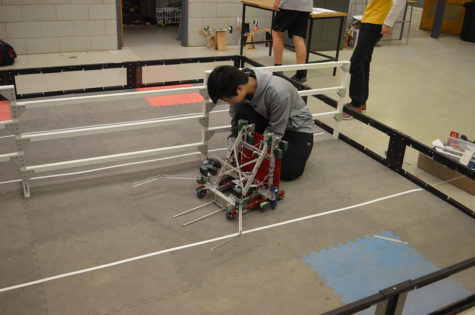 "Junior Raymond Zou tests his robot during routine practice at the Robotics Club meeting in room 236 Feb. 28 in preparation for the state competition March 3 and March 4. His was one of six of the school's teams competing in the event, which included 60 teams total.     He and the other members of VEX robotics team 1727G—junior Josh Lim, sophomore Beulah Lee and freshmen Samuel Wu, Ben Yin and Cindy Jia will compete in the VEX Worlds 2017 competition April 19 through 22 in Louisville, Ky. In the meantime, the team is working on redesigning their robot and building game strategy, Zou said.      ""There is a lot of game strategy involved in Robotics. You can have a well-built robot, but without game strategy, you won't win. If you have a mediocre robot, but good strategy, you have a stronger chance to win,"" said Zou."