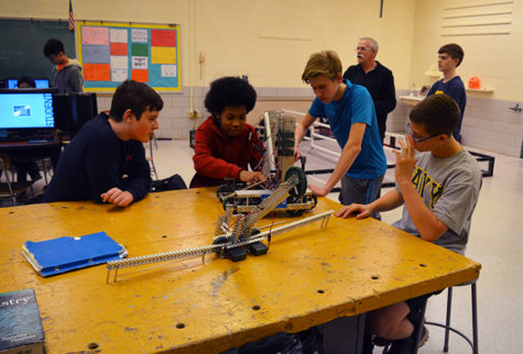 One of the school's robotics teams prepare for the state championship after school Feb. 28. Six teams here qualified for the event, which will take place March 4 at Dundalk Technical High School.