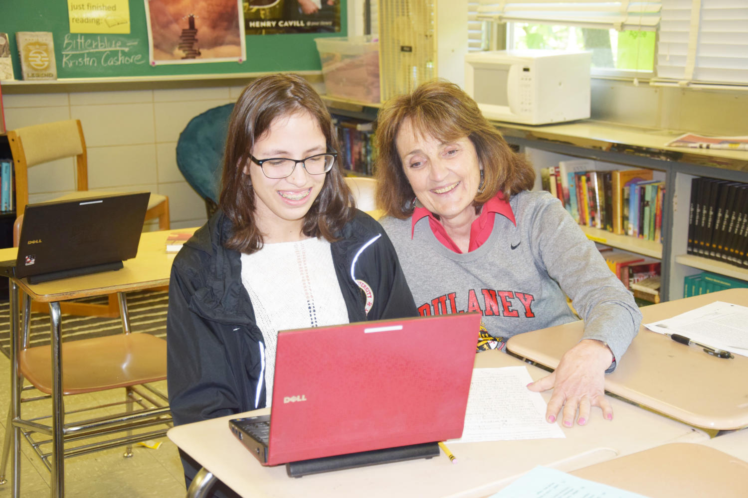 Sophomore Jada Nash and English and special education teacher Barbara Valle work on an English assignment May 8 using the school's laptops.
