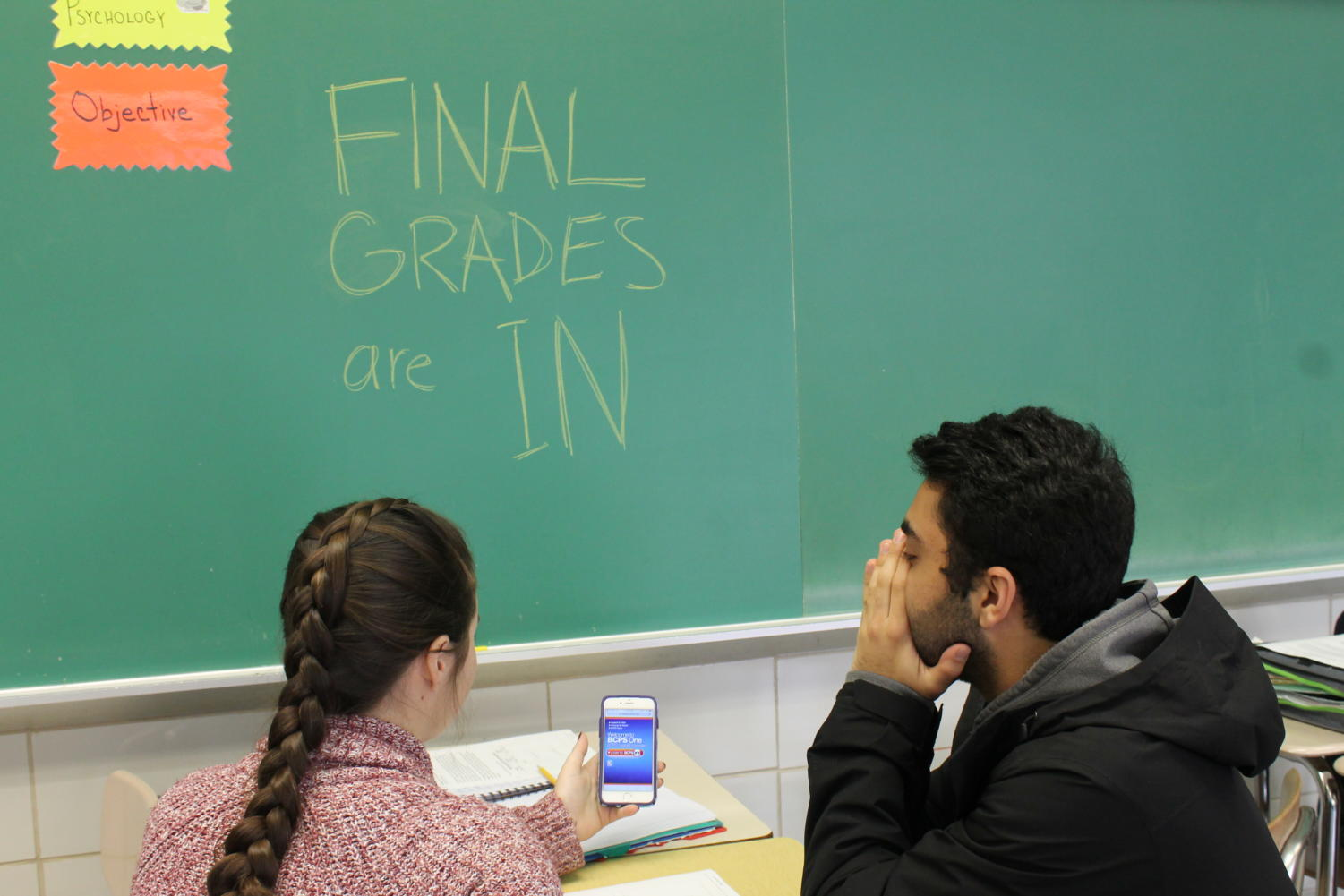 "Seniors Madi Sedgwick and Sepehr Akhtarkhavari stress over final quarter grades in room 103 Nov. 9. Akhtakhavari described the anxiety grades cause as overwhelming .""The pressure of schoolwork and responsibilities makes you want to curl up into a ball and cry,"" he said"