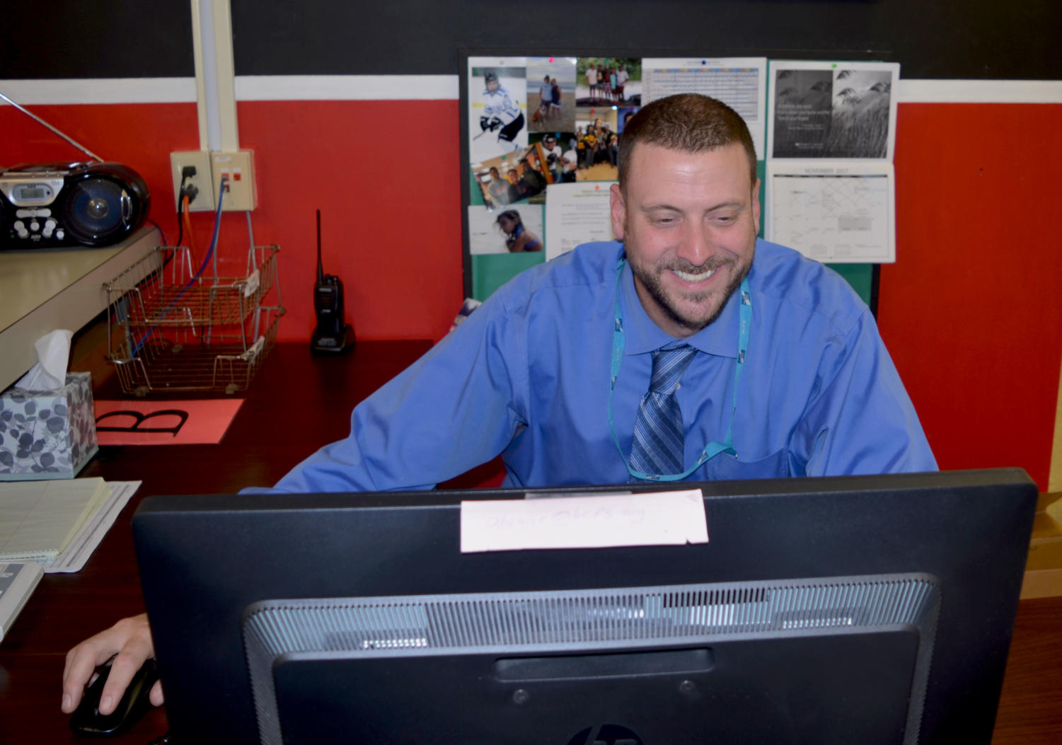 Principal Samuel Wynkoop works at his desk Nov. 13.